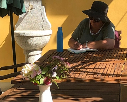 Writing on the Vine Terrace at The Watermill, Tuscany