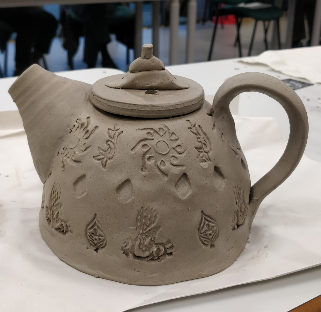 Teapot made with Muddy Fingers Pottery